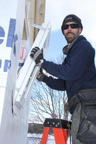Matt installing a window.