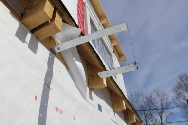 Tension tie to hold walls together.