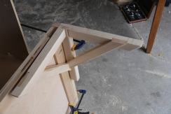 Mounting bracket to couch frame