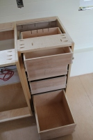Fling cabinet and charging drawer