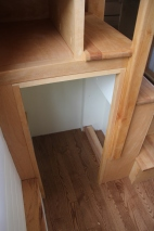 Cubby under the stairs -- much needed storage space.