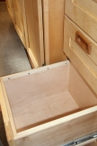 File drawer with hard wood rails to hold file folders.
