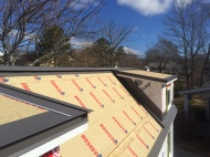 The trim and flashings take longer than the steel sheets but are critical to get right